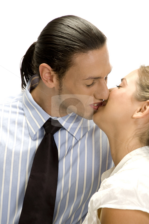 Kissing couple posing stock photo, Kissing couple posing with white background by Imagery Majestic