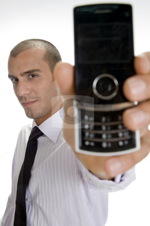 Young businessman holding mobile stock photo, Young businessman holding mobile on an isolated background by Imagery Majestic
