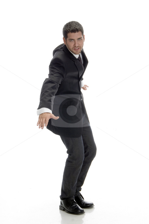 Businessman looking to camera stock photo, Businessman looking to camera against white background by Imagery Majestic