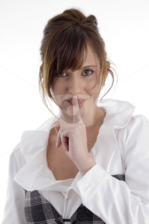 Smiling woman instructing you to keep silent stock photo, Smiling woman instructing you to keep  silent on an isolated background by Imagery Majestic