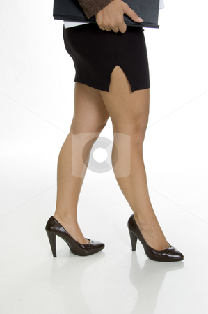 Businesswoman legs stock photo, Businesswoman legs on an isolated white background by Imagery Majestic
