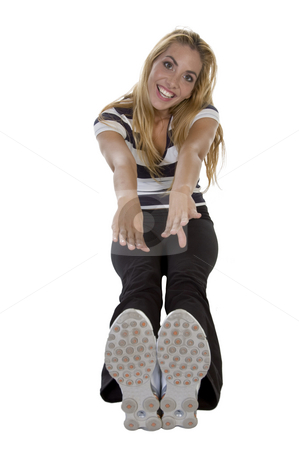 Blonde lady stretching her hads and feet stock photo, Blonde lady stretching her hads and feet on an isolated background by Imagery Majestic