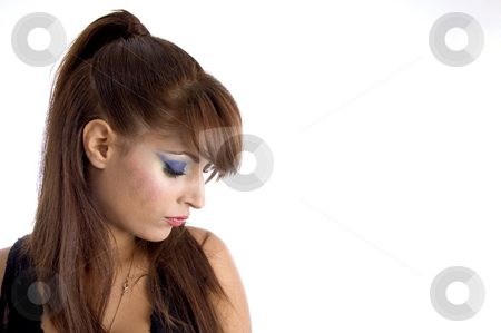Glamorous model looking downward stock photo, Glamorous model looking downward on an isolated white background by Imagery Majestic