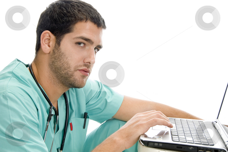 Doctor with laptop stock photo, Doctor with laptop with white background by Imagery Majestic