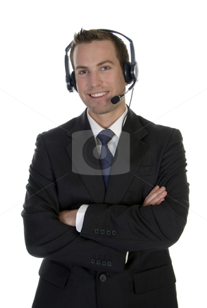 Standing businessman with microphone stock photo, Standing businessman with microphone on white background by Imagery Majestic