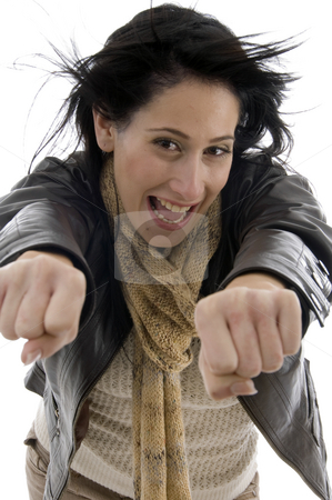 Woman showing clenched fists stock photo, Woman showing clenched fists on an isolated white background by Imagery Majestic