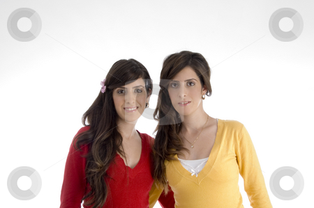 Portrait of smiling sisters stock photo, Portrait of smiling sisters on an isolated background by Imagery Majestic