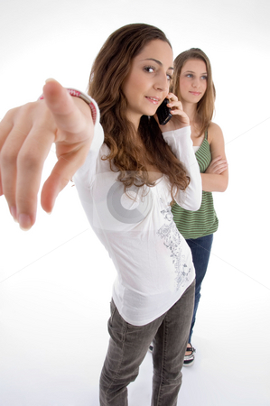 Teenager beautiful young girls posing with hand gesture stock photo, Teenager beautiful young girls posing with hand gesture against white background by Imagery Majestic