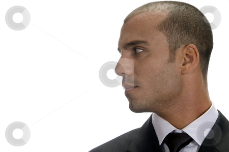 Side view of young executive stock photo, Side view of young executive isolated on white background by Imagery Majestic