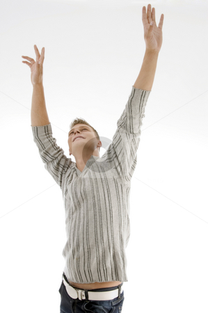 Smiling man stretching his arms stock photo, Smiling man stretching his arms on an isolated white background by Imagery Majestic