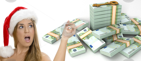Three dimensional  key and bundles of euro money and a sexy lady with santa hat stock photo, Three dimensional  key and bundles of euro money and a sexy lady with santa hat on an isolated white background by Imagery Majestic