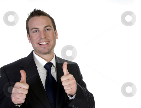 Happy businessman with his hand going thumbs up stock photo, Happy businessman with his hand going thumbs up with white background by Imagery Majestic