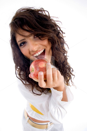 Woman going to eat apple stock photo, Woman going to eat apple on an isolated background by Imagery Majestic