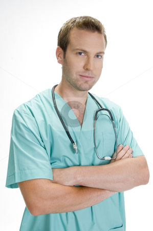 Doctor posing with crossed arms and stethoscope stock photo, Doctor posing with crossed arms and stethoscope by Imagery Majestic