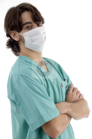 Doctor in scrubs and facemask stock photo, Doctor in scrubs and facemask isolated on white background by Imagery Majestic
