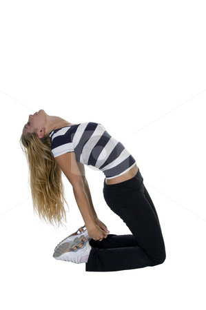 Woman bending stretching her back stock photo, Woman bending stretching her back isolated with white background by Imagery Majestic