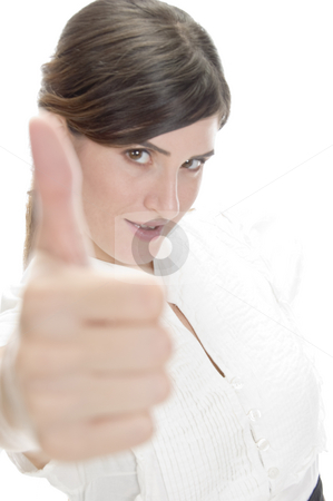 Smiling lady showing approval sign stock photo, Smiling lady showing approval sign against white background by Imagery Majestic