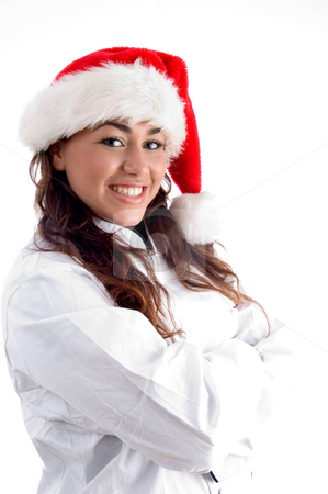 Smiling young woman wearing christmas hat stock photo, Smiling young woman wearing christmas hat on an isolated white background by Imagery Majestic