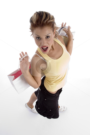 High angle view of sexy woman with shopping bag stock photo, High angle view of sexy woman with shopping bag on an isolated background by Imagery Majestic
