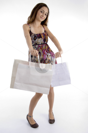 Pretty woman with shopping bag stock photo, Pretty woman with shopping bag against white background by Imagery Majestic