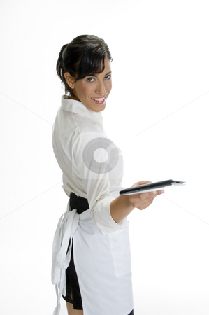 Smiling waitress showing bill book stock photo, Smiling waitress showing bill book on white background by Imagery Majestic