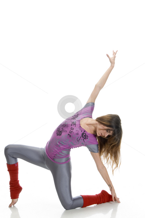 Young female doing dance stock photo, Young female doing dance against white background by Imagery Majestic
