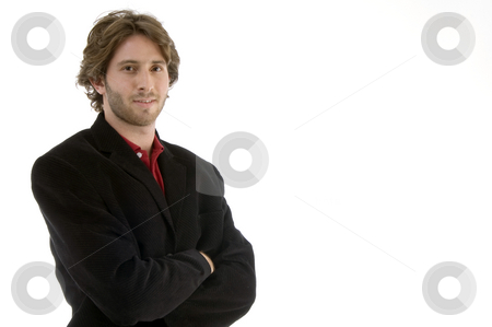 Young man with folded hands stock photo, Young man with folded hands on an isolated white background by Imagery Majestic