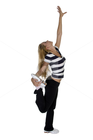 Excercising blonde lady stock photo, Excercising blonde lady isolated on white background by Imagery Majestic