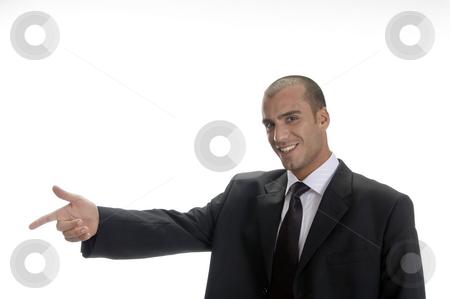 Happy businessman pointing stock photo, Happy businessman pointing in front by Imagery Majestic