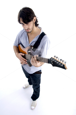 Young man playing electric guitar stock photo, Handsome male looking at camera and playing guitar on an isolated white background by Imagery Majestic