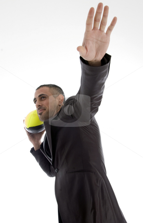 Male with rugby ball stock photo, Male with rugby ball against white background by Imagery Majestic