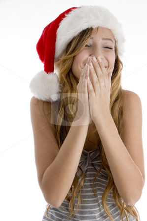 Laughing girl with christmas hat stock photo, Front view of laughing girl with christmas hat on  an isolated white background by Imagery Majestic