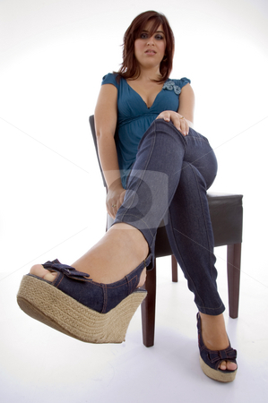 Sitting female model stock photo, Sitting female model with white background by Imagery Majestic