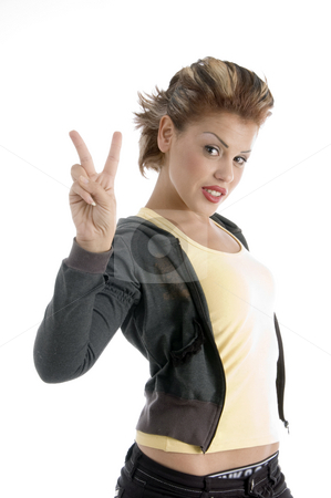 Young woman showing winning gesture stock photo, Young woman showing winning gesture on an isolated background by Imagery Majestic