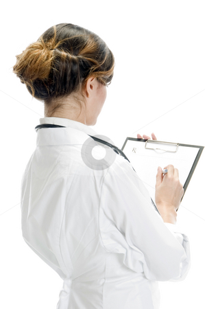 Doctor writing on paper stock photo, Doctor writing on paper against white background by Imagery Majestic