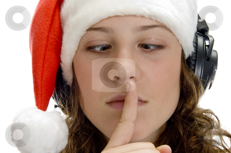 Woman instructing to keep silent and looking squint stock photo, Woman instructing to keep silent and looking squint on an isolated white background by Imagery Majestic