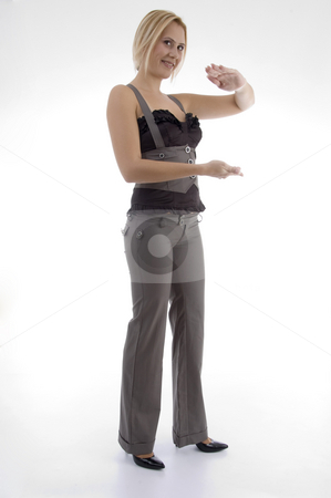 Standing woman making hand gesture stock photo, Standing woman making hand gesture on an isolated background by Imagery Majestic