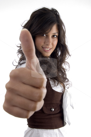 Young model with thumbs up hand gesture stock photo, Young model with thumbs up hand gesture on an isolated white background by Imagery Majestic