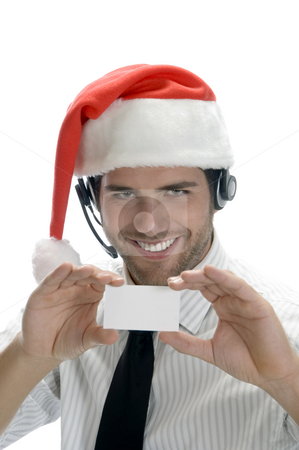Businessman holding visiting card stock photo, Businessman holding visiting card on an isolated white background by Imagery Majestic