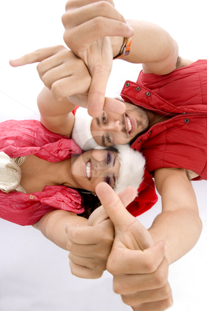 Laying lovers showing hand gesture stock photo, Laying lovers showing hand gesture with white background by Imagery Majestic