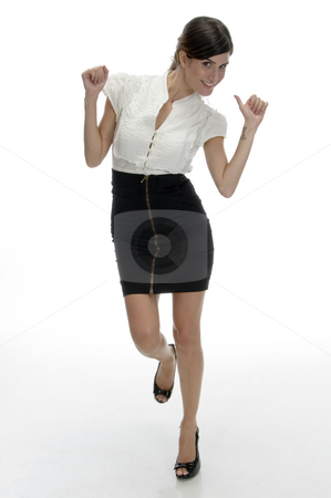 Dancing beautiful model stock photo, Dancing beautiful model on an isolated white background by Imagery Majestic