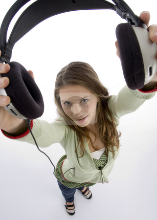 High angle view of female showing headset stock photo, High angle view of female showing headset against white background by Imagery Majestic