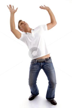 Man looking upwards and posing like holding something stock photo, Man looking upwards and posing like holding something with white background by Imagery Majestic
