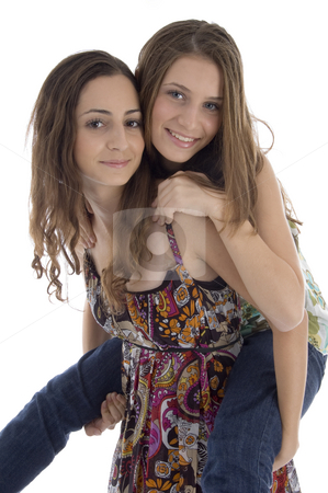 Young friends riding piggyback stock photo, Young friends riding piggyback against white background by Imagery Majestic