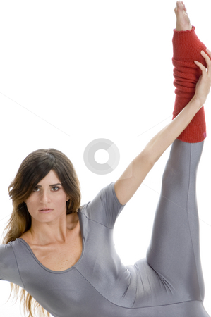 Woman stretching her leg stock photo, Woman stretching her leg against white background by Imagery Majestic