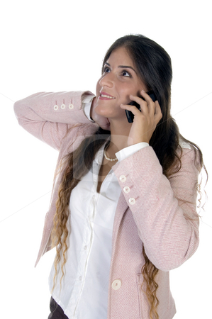 Standing woman talking on mobile stock photo, Standing woman talking on mobile against white background by Imagery Majestic