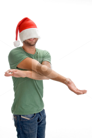 Male hiding his face with santa cap stock photo, Male hiding his face with santa cap on an isolated background by Imagery Majestic