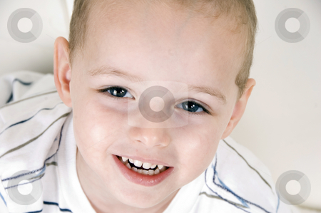 Cute smiling boy stock photo, Cute smiling boy looking at camera by Imagery Majestic