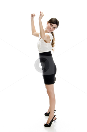 Smiling lady showing the winning sign stock photo, Smiling lady showing the winning sign with white background by Imagery Majestic