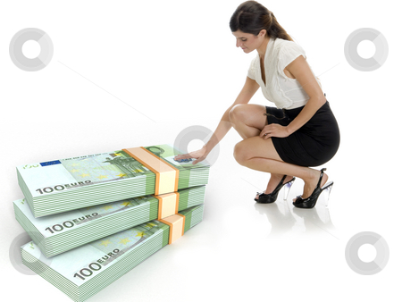Businesswoman and three dimensional bundles of europian currency  stock photo, Businesswoman and three dimensional bundles of europian currency on an isolated white background by Imagery Majestic